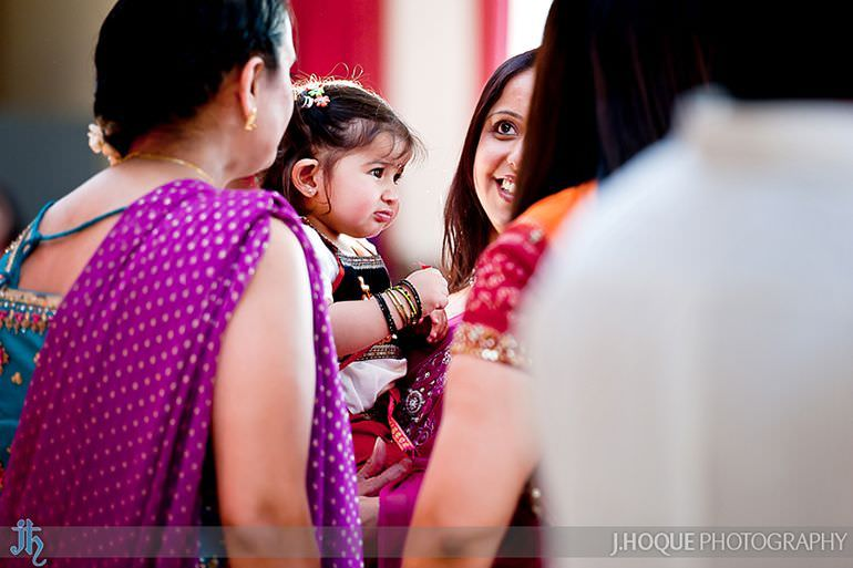 Shot of child through crowd | Saanji | Sanjay Gohil | Indian Wedding Photography London | 0172