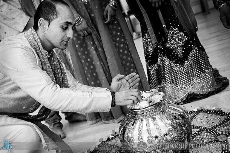 Groom lighting the Garbo pot | Saanji | Sanjay Gohil | Indian Wedding Photography London | 2932