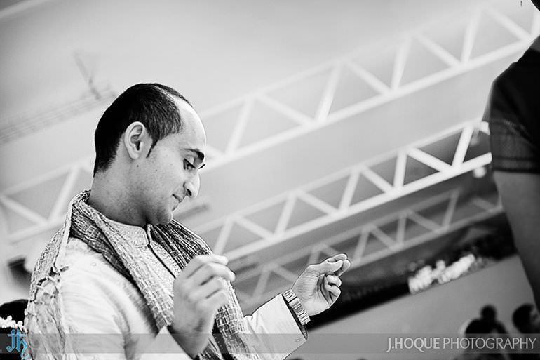 Groom enjoying garba | Sanjay Gohil Saanji in Harrow | Indian Wedding Photography London | 2959-BW