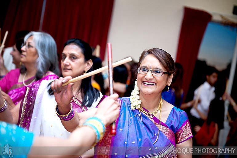 Grooms Mum performing Dandia Raas | Sanjay Gohil Saanji in Harrow | Indian Wedding Photography London | 3330