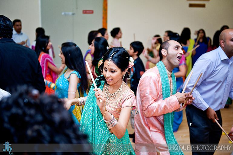 Groom making funny face during dandia raas | Sanjay Gohil Saanji in Harrow | Indian Wedding Photography London | 3382