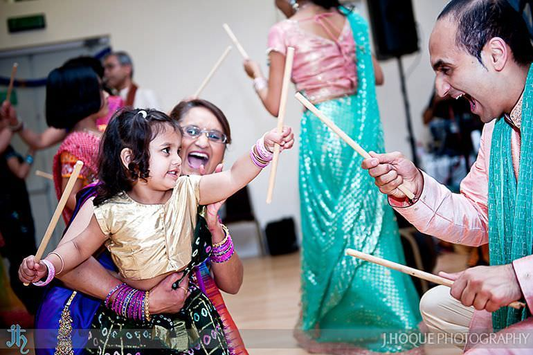 Groom performing Dandia Raas with niece | Sanjay Gohil Saanji in Harrow | Asian Wedding Photography London | 3438