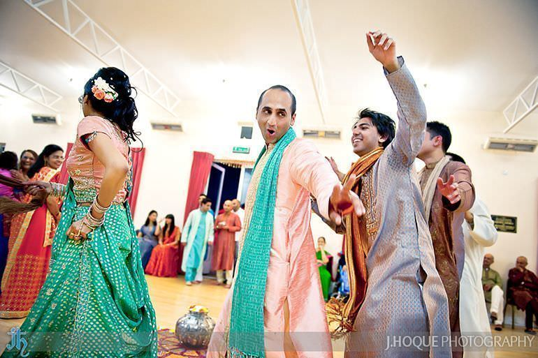 Grooms funny expression while performing Garba | Sanjay Gohil Saanji in Harrow | Asian Wedding Photography London | 3634