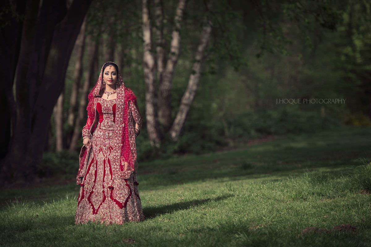 Bride portrait in pocket of sunlight | Muslim Wedding at Fairlop Waters Essex