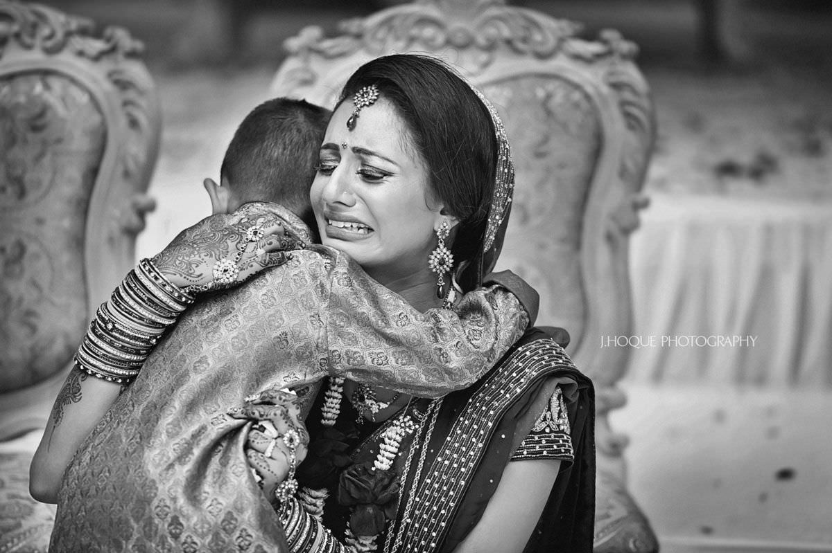 Bride and nephew crying during Vidaai ceremony | Hindu Wedding Photographer London