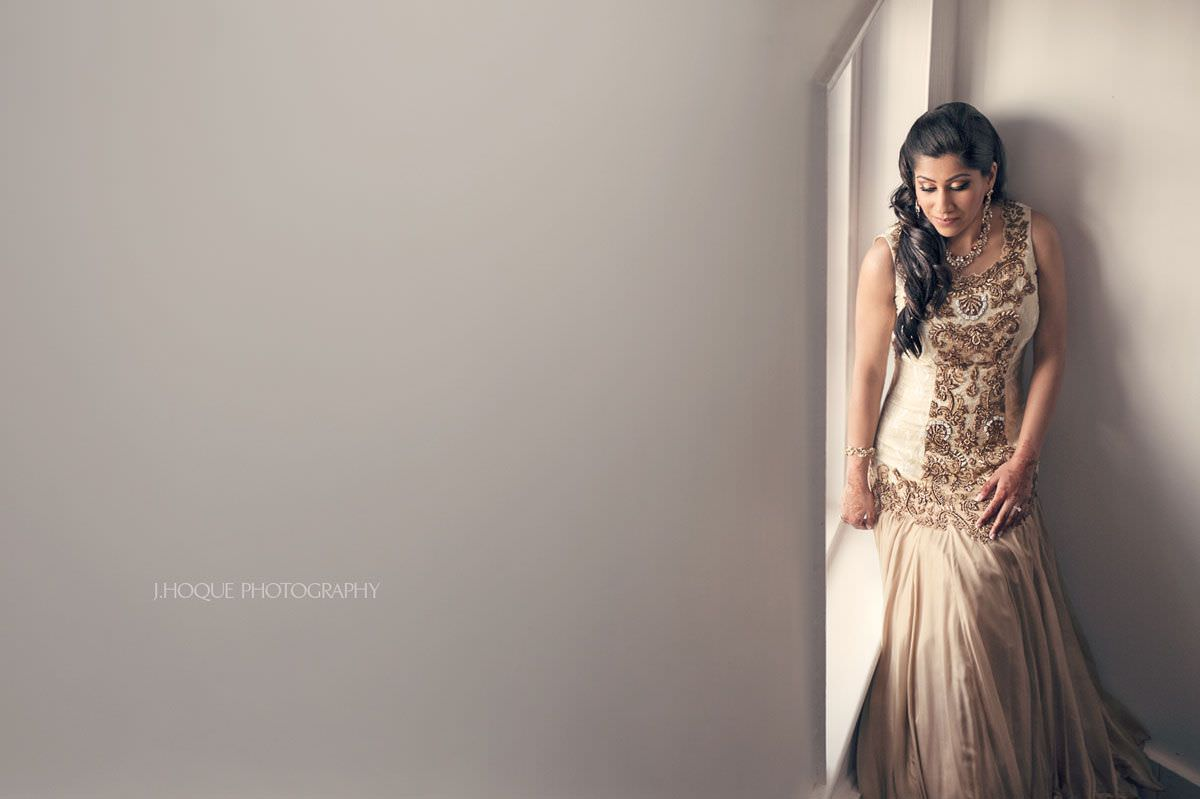 Indian Bride portrait by window | Gujarati Tamil Fusion Wedding at Boreham House Essex
