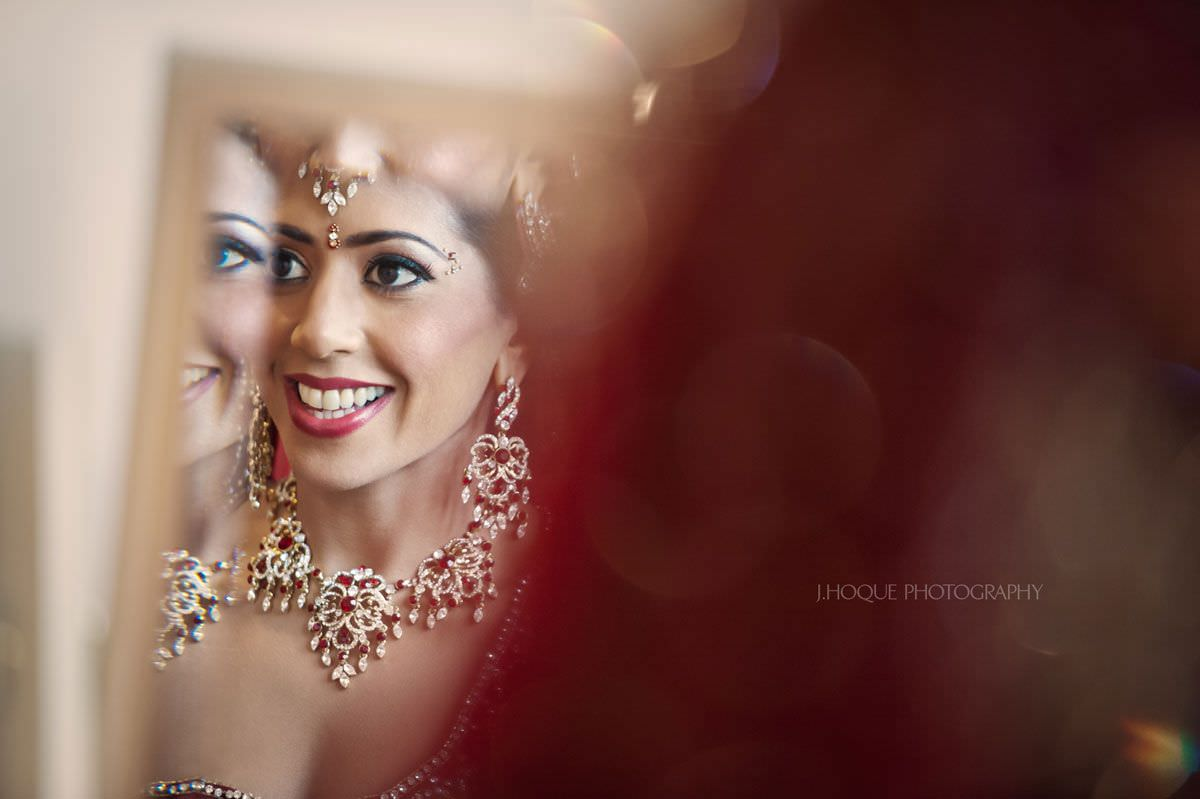 Reflection of bride | Sikh wedding at Cobham Hall Kent