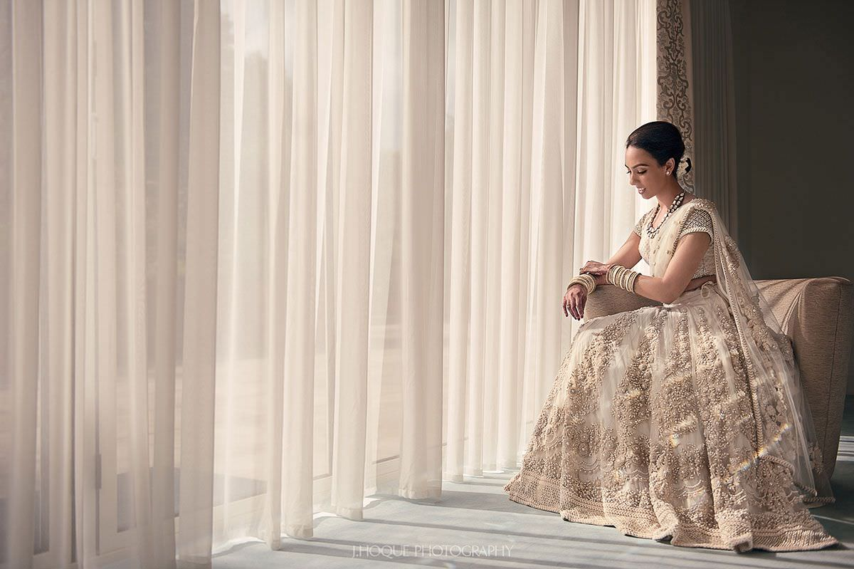 Elegant bride portrait by window | Indian Fusion Wedding Photography London