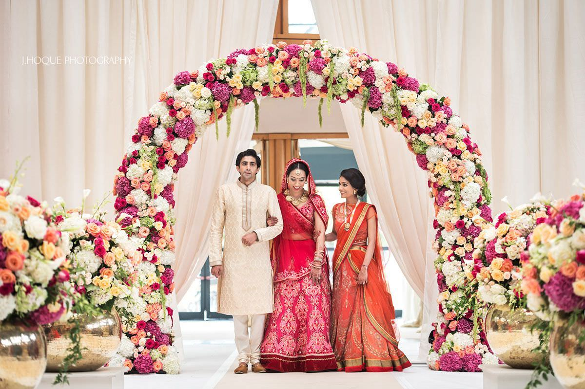Brides entrance with sister and brother-in-law | Indian Fusion Wedding Photographer London