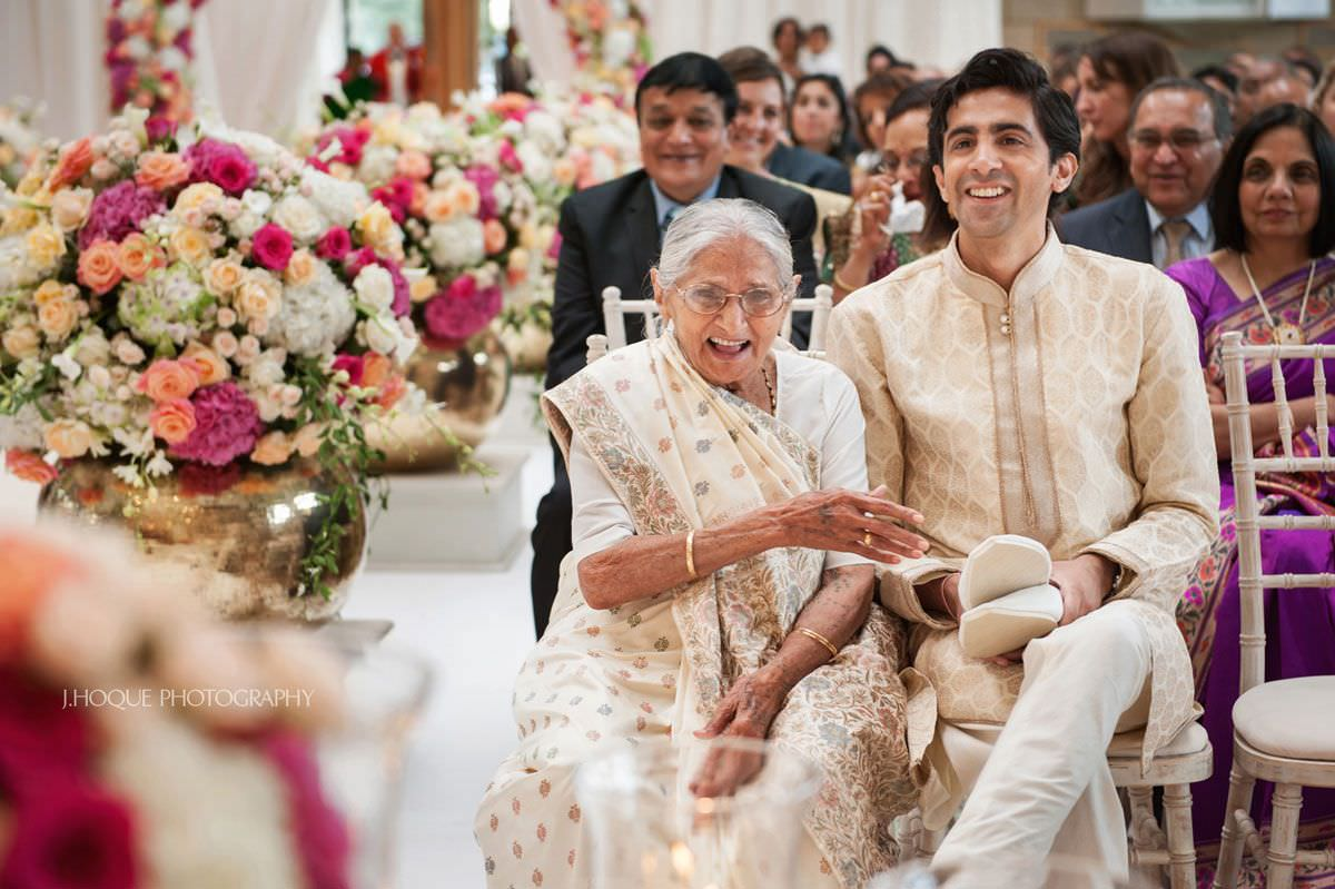 Sharing a joke with grandma | Fusion Indian Wedding Photographer London