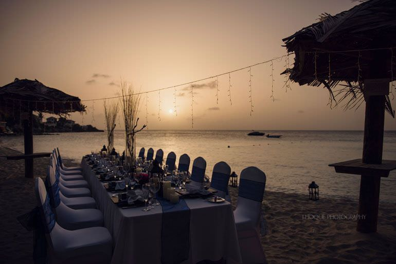 Wedding breakfast on Blue Waters beach at sunset - Caribbean Destination Wedding Antigua | CIV-0835