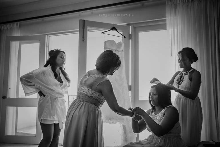Bride getting ready in Cove Suites Blue Waters Resort Antigua | CIV-0129