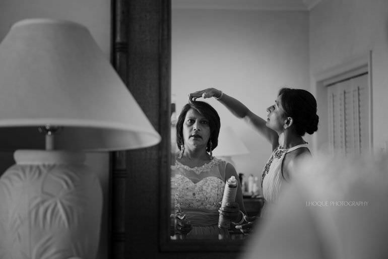 Brides mum getting ready in Cove Suites Blue Waters Resort Antigua | CIV-0248