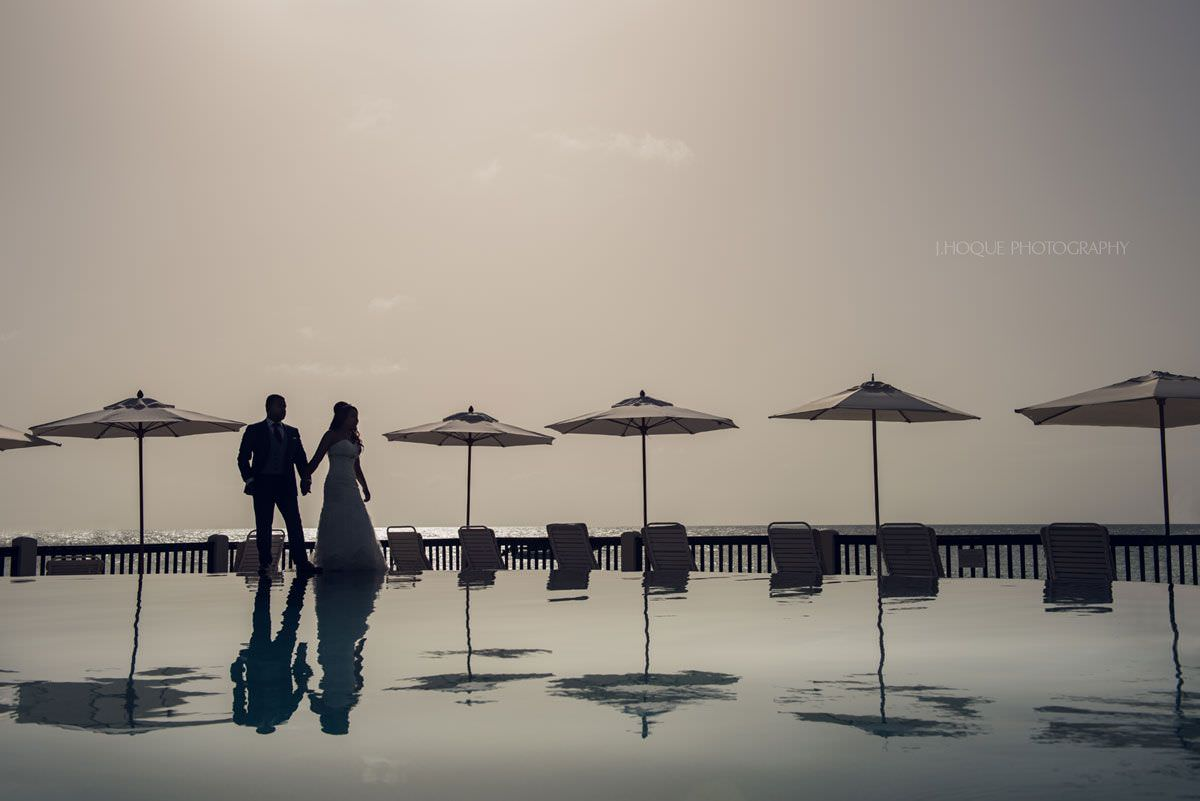 Couple portrait by infinity pool | Antigua Indian Destination Wedding