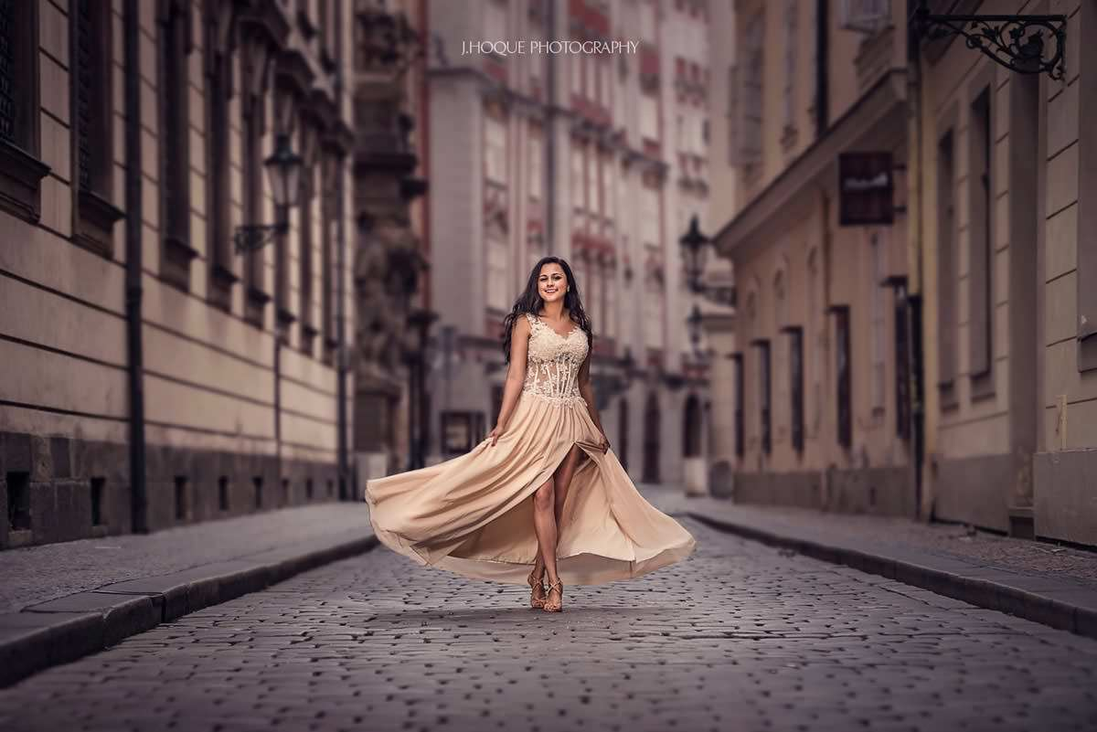 Bride twirling in Prague street | Destination Engagement Shoot