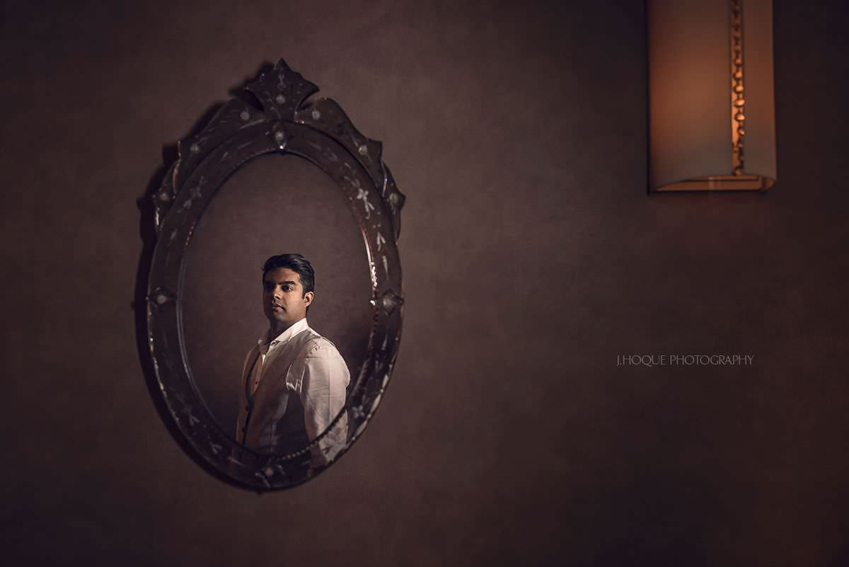 Groom reflection in mirror | Asian Destination Wedding Photographer | Prague Pre Wedding