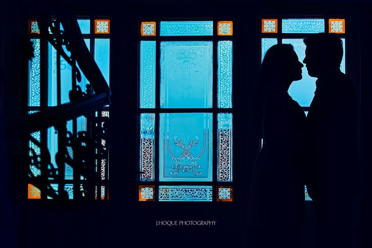 Silhouette by window at Mamaison Riverside Hotel | Asian Destination Wedding Photographer | Prague Pre Wedding
