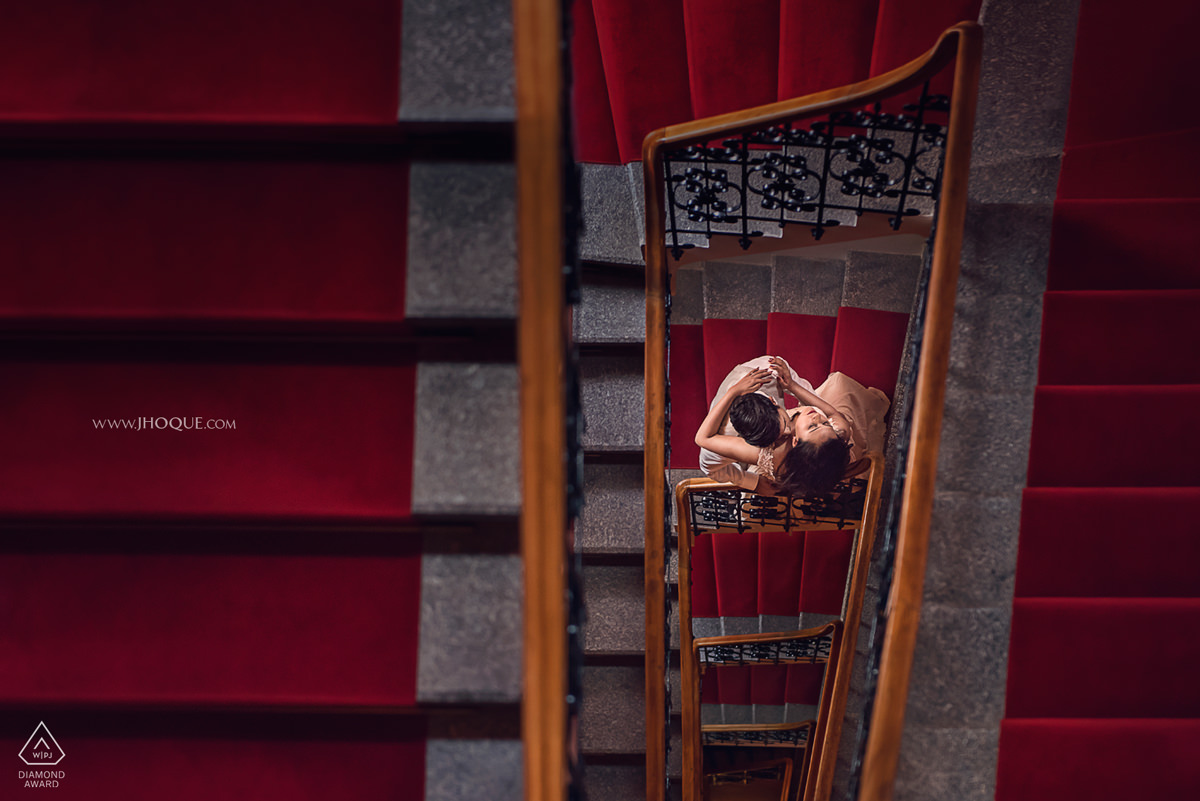 Portrait on red carpeted staircase | Prague Pre Wedding | Asian Destination Wedding Photographer