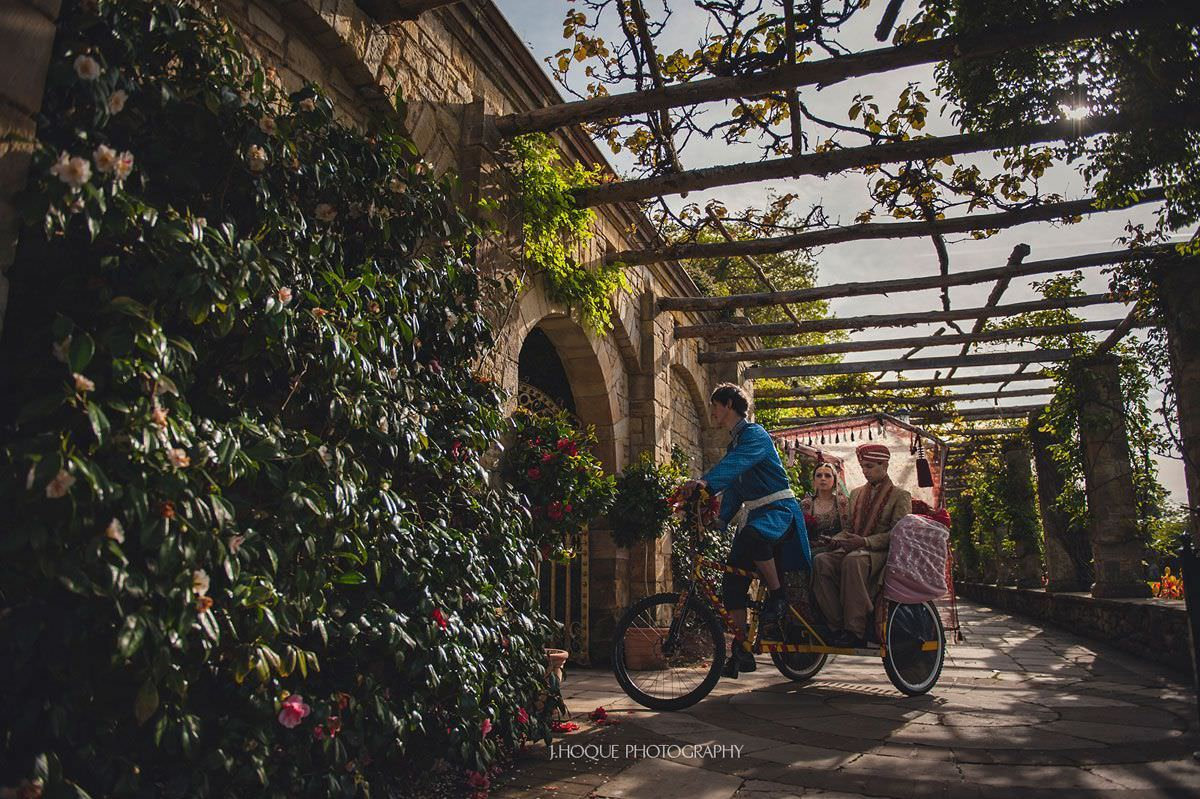 Bride and groom entrance on rickshaw | Hever Castle Muslim Wedding Photography Kent