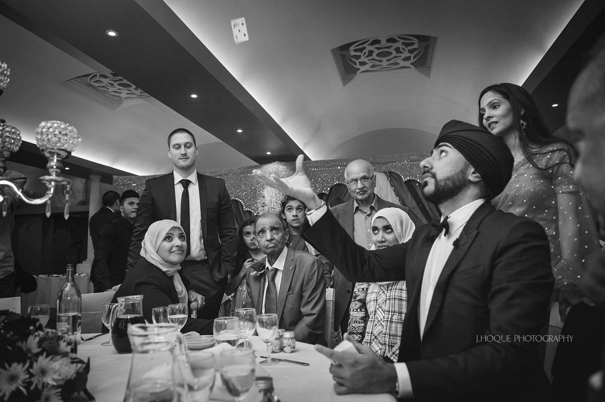 Magic Singh performing trick at Hever Castle Wedding |  Asian Wedding Photographer Kent
