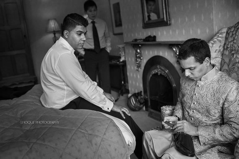 Groom fixing shoe | Asian Wedding Photography Kent | Hever Castle | 0008-BW