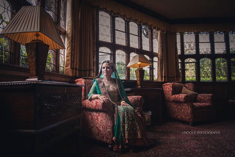 Muslim Bride portrait by window | Asian Wedding Photography Kent | Hever Castle | 0097