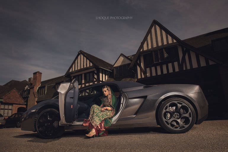 Bride stepping out of Lamborghini   Hever Castle Asian Documentary Wedding Photography Kent   0221