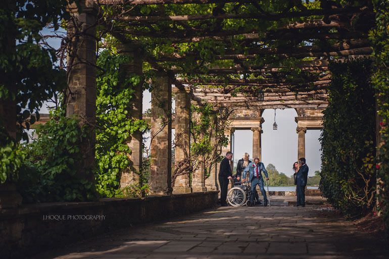 Brides father getting out of wheelchair | Hever Castle Asian Wedding | Kent Wedding Photographer | 0247