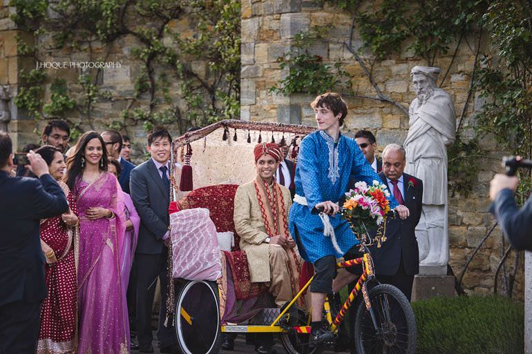 Groom enters on rickshaw | Muslim Documentary Wedding Photography Kent | Hever Castle | 0257