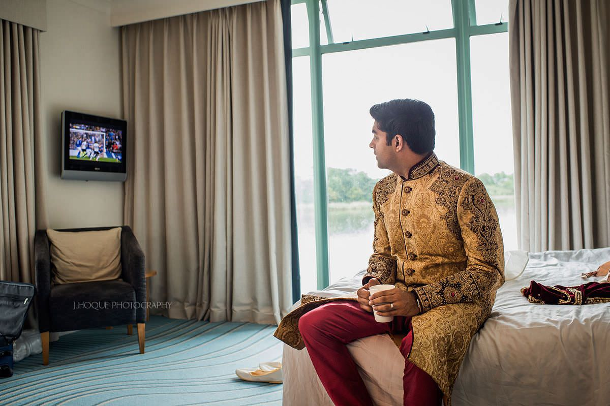 Groom watching football before wedding ceremony | Indian Wedding at Four Pillars Hotel Cotswolds