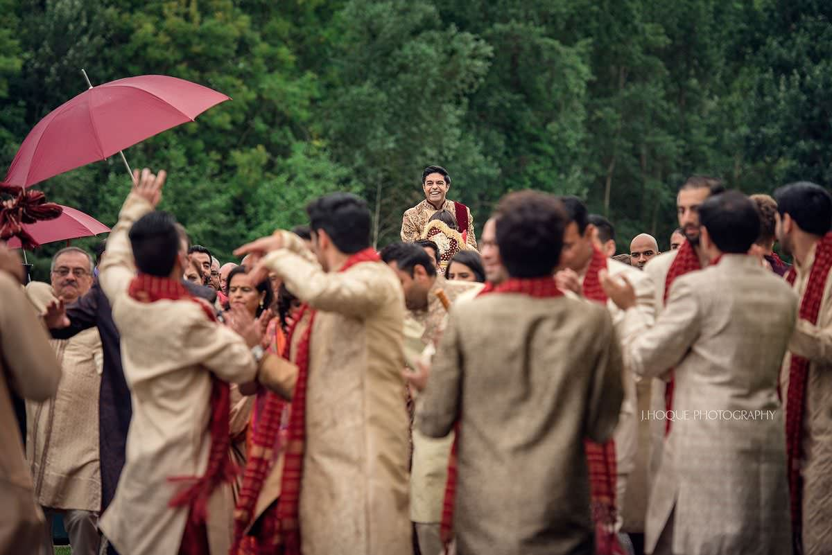 Indian groom arriving on horse | Asian wedding at Cotswold Water Park Four Pillars Hotel