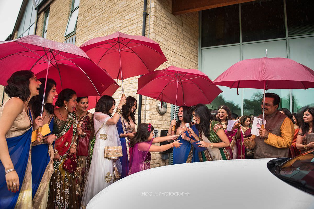 Vidai in the rain | Indian wedding at Cotswold Water Park Hotel | Gloucestershire Wedding Photographer