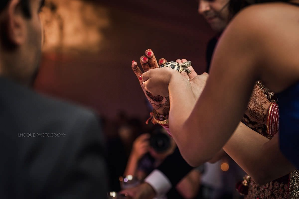 Bride presented with turtle | Cotswold Water Park Hotel | Indian Wedding Photographer Gloucestershire