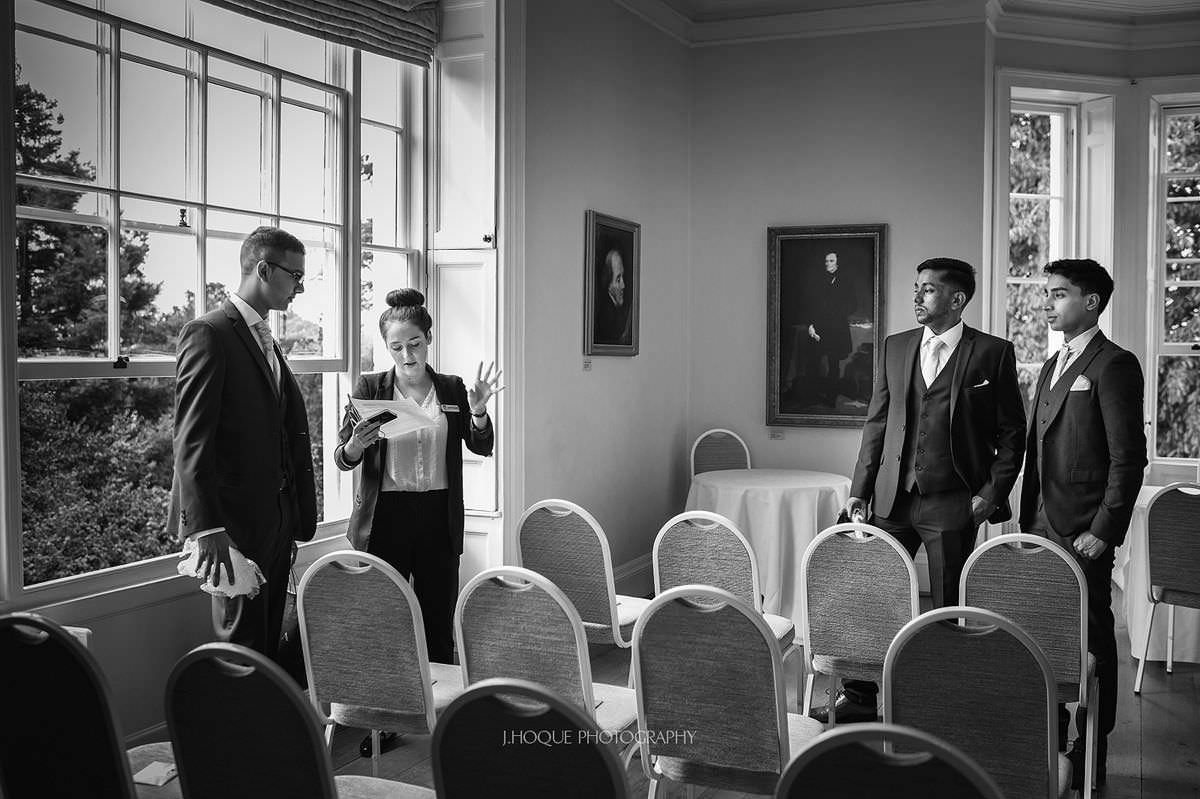Final checks with wedding coordinator | Pembroke Lodge Wedding Photographer Richmond Surrey | 03