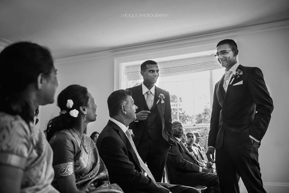 Tamil Groom mingling with family | Pembroke Lodge Tamil Wedding Photographer Surrey | 06