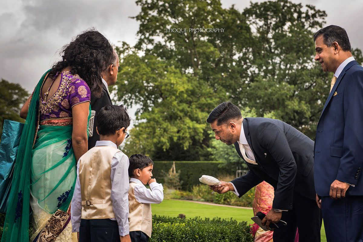 Best man negotiating with ring bearer | Pembroke Lodge Tamil Wedding Photographer Surrey | 08