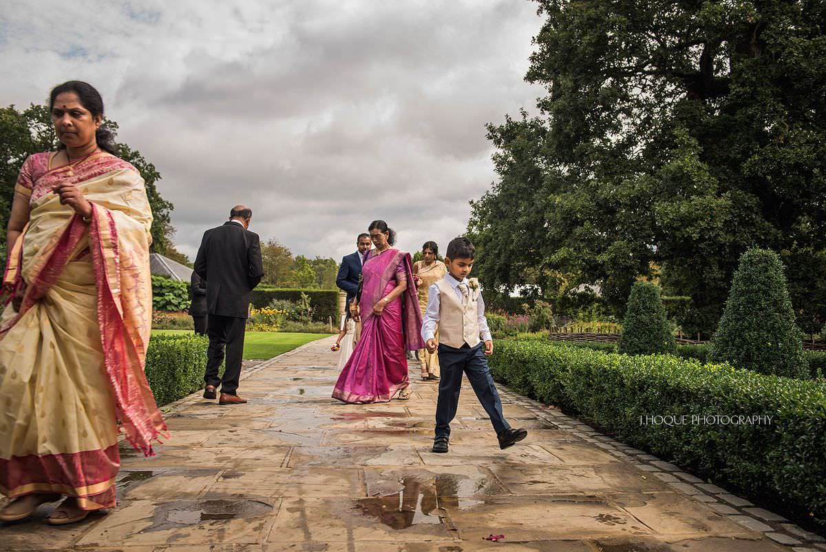 Avoiding a puddle | Pembroke Lodge Tamil Wedding Photographer Surrey | 10