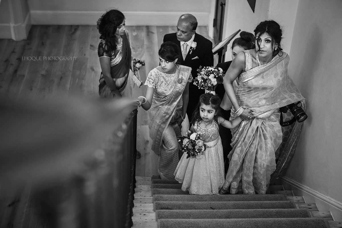 Bride and family walking up stairs | Pembroke Lodge Tamil Wedding Photographer Surrey | 11