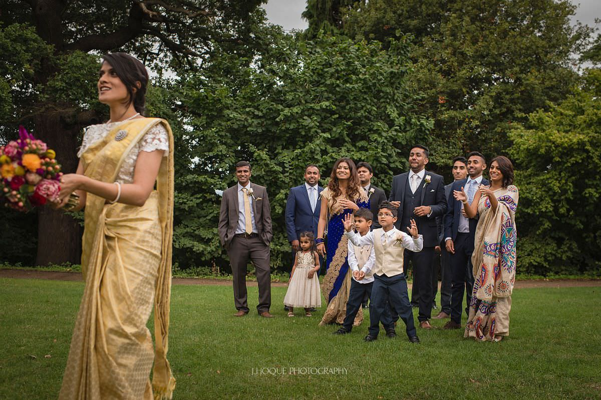 Ready to catch bouquet | Pembroke Lodge Tamil Wedding Surrey | 20