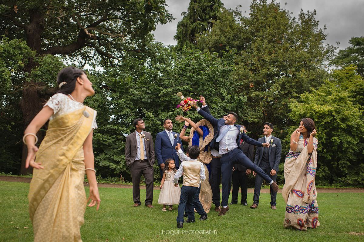 Best man, bridesmaid and kids competing for bouquet | Pembroke Lodge Tamil Wedding Surrey | 21