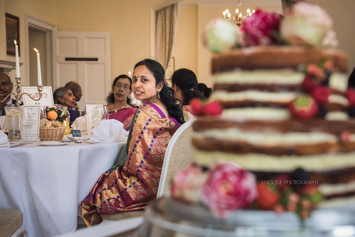 Grooms mum admiring brides handmade cake | Surrey Documentary Wedding Photography Pembroke Lodge | 24