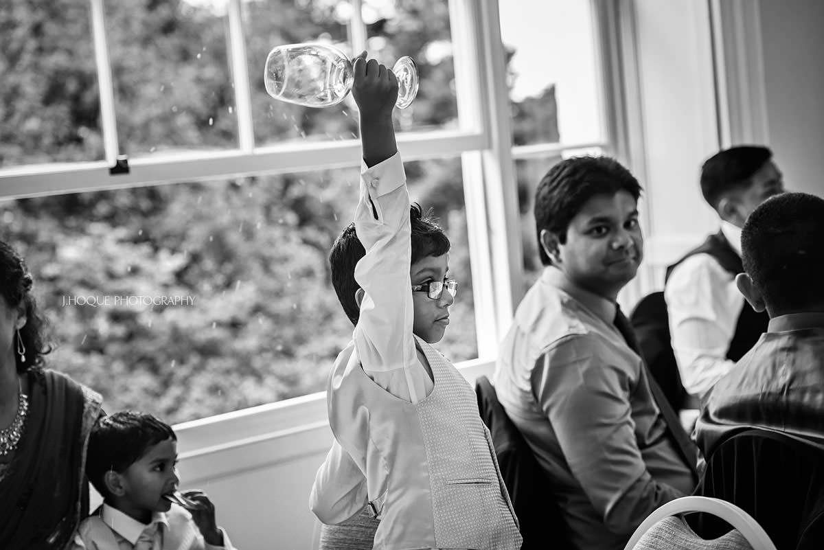 Brides nephew raises a glass | Surrey Tamil Wedding Photographer Pembroke Lodge | 27