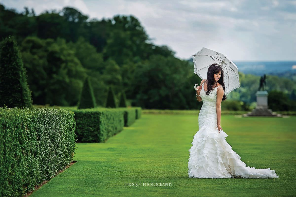 Bride with stylish umbrella | Luxury Tamil Wedding Photographer Cliveden House Berkshire