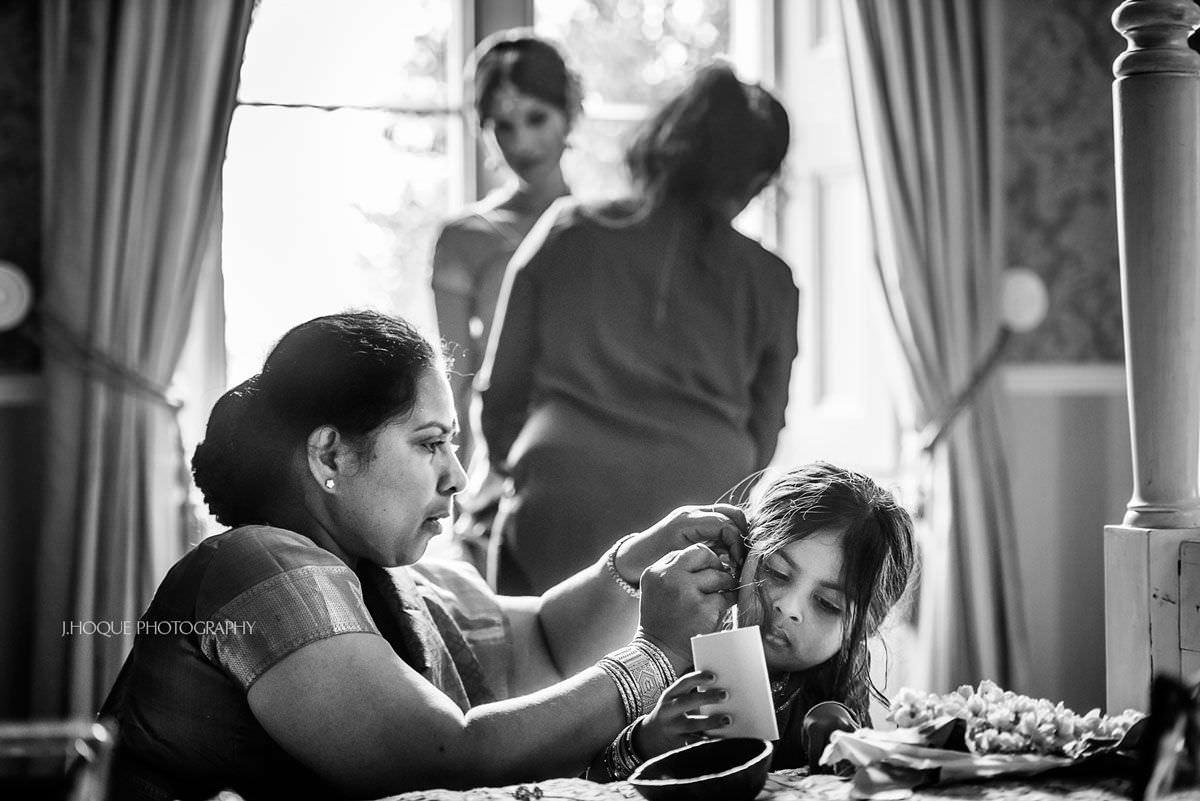 Brides mum helping niece get ready | Shendish Manor Tamil Hindu Wedding | Hertfordshire Wedding Photography | BW-08