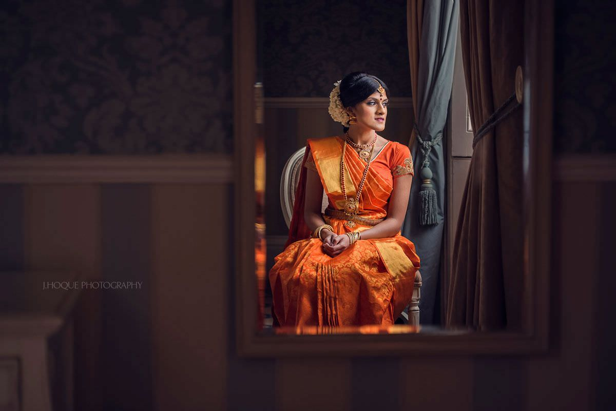 Reflection of Tamil Bride wearing orange saree | Shendish Manor Hindu Wedding Photography Hertfordshire | 10