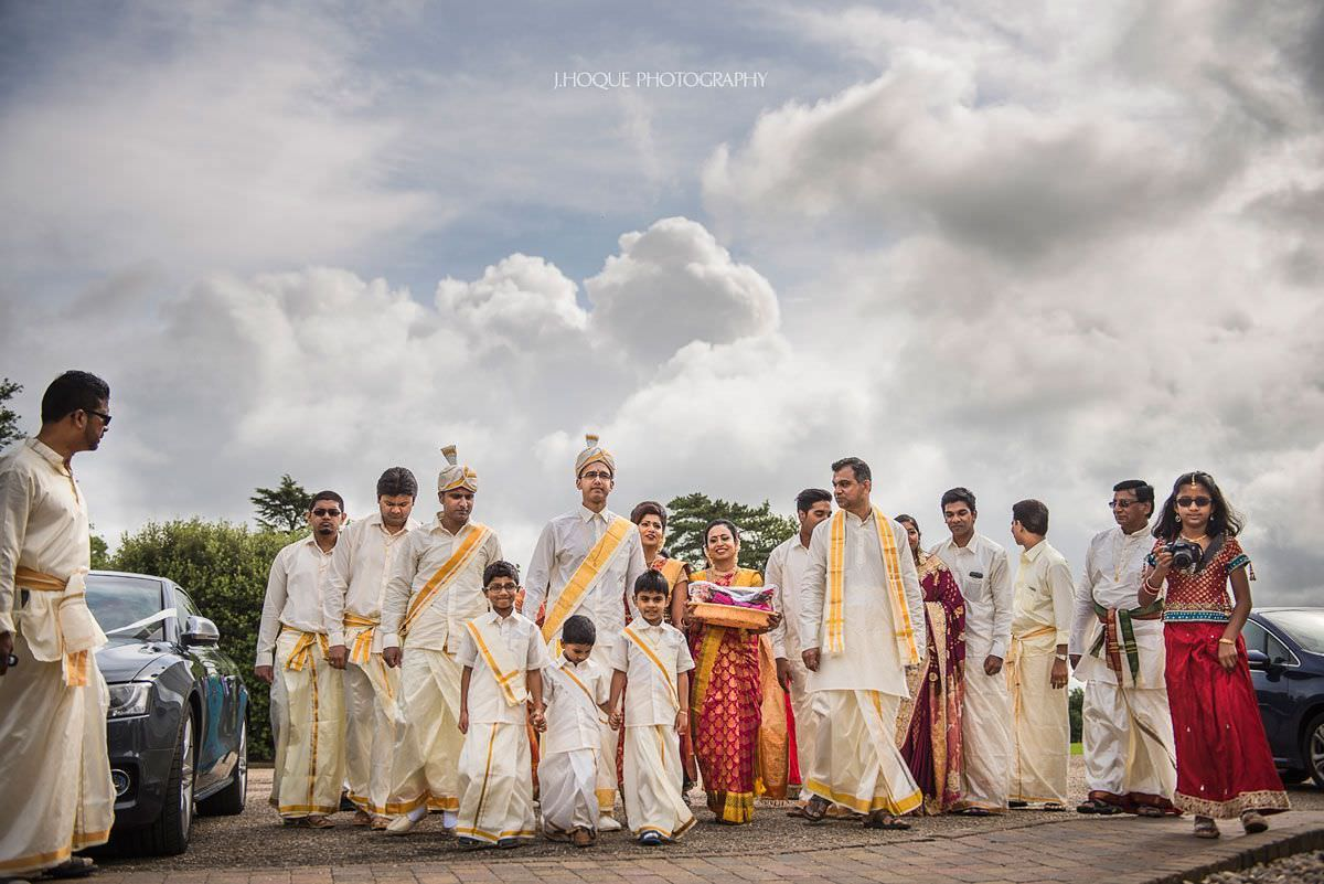 Groom and wedding party arrive wearing traditional Tamil clothes | Shendish Manor Hindu Wedding Hertfordshire | 16