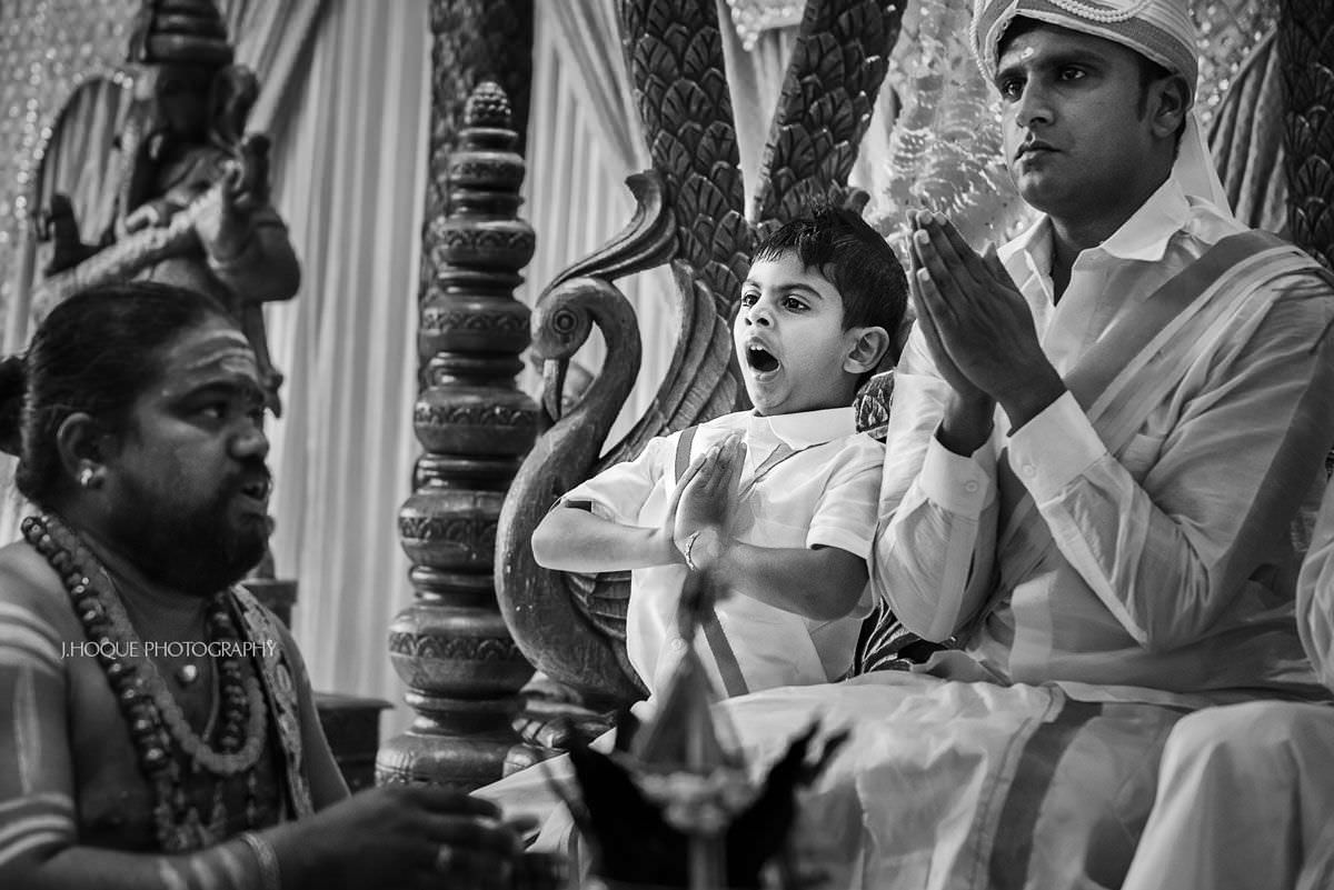 Boy yawning during Hindu wedding ceremony | Tamil Wedding at Shendish Manor