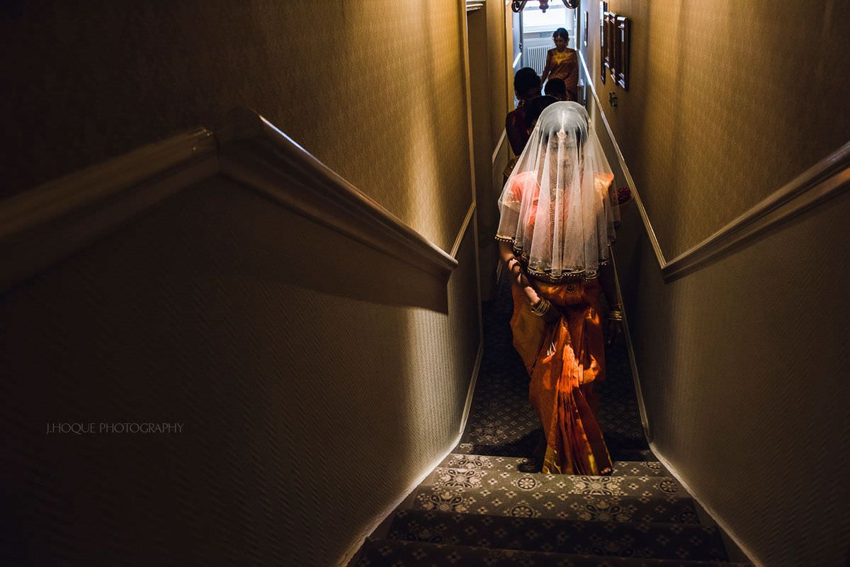 Tamil bride under spotlight in corridor | Shendish Manor Sri Lankan Wedding Ceremony | 28