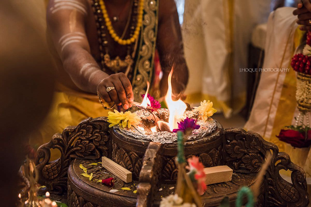 Priest lighting fire for Hindu wedding ritual | Shendish Manor Tamil Wedding Photographer Hertfordshire | 40