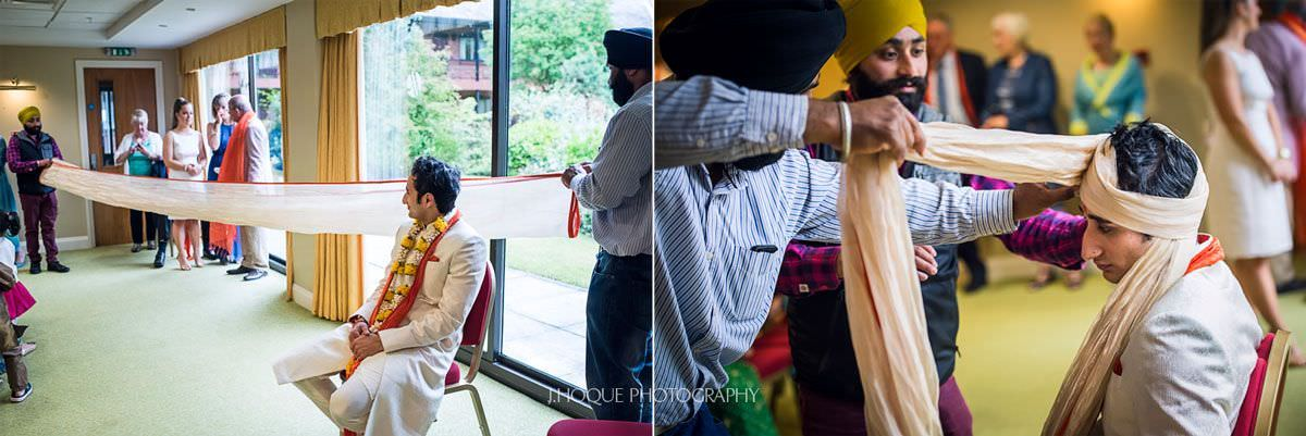 Groom having his pagg (Turban) tied | Panjabi Hindu Wedding Photography Cheshire | 05